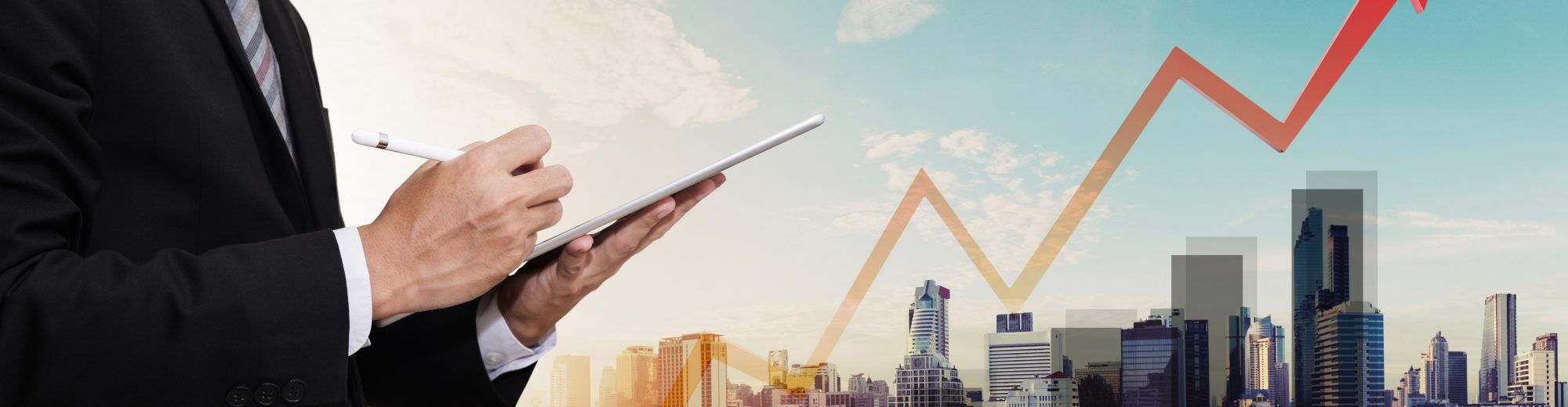 Businessman working on digital tablet, with panorama city view and raising up graph and arrow, representing business growth